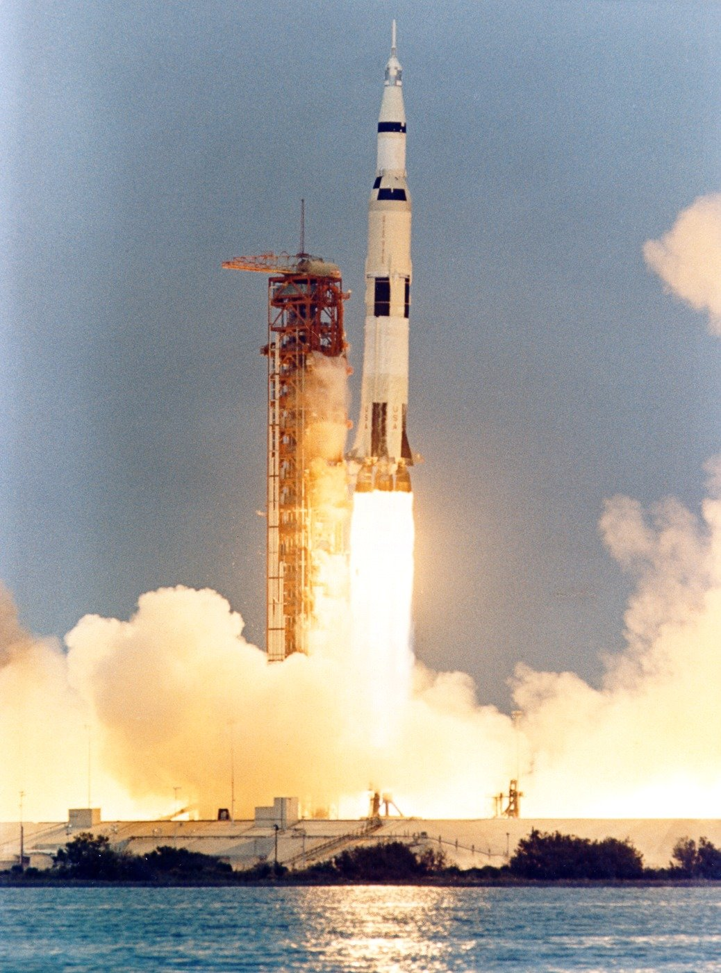Apollo 13 yaws away from the launch tower during lift-off ...