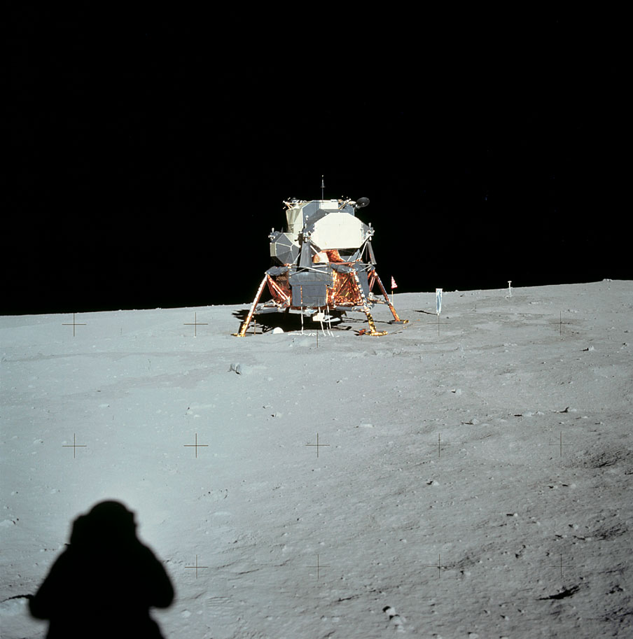 a history of the moon landing in 1969 Astronaut edwin f aldrin jr, lunar module pilot, faces the camera as he walks on  the moon july 20, 1969 the plexiglass of his helmet reflects back the scene in.