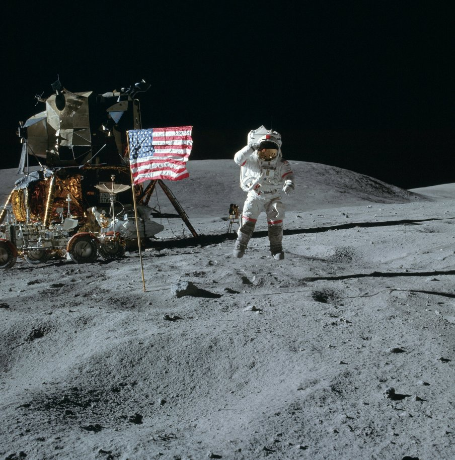 Apollo astronaut John Young leaps and salutes the flag on the moon