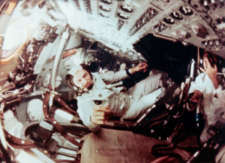 Apollo 8 interior, Commander Frank Borman at center, NASA photo ap8-S68-56531.jpg