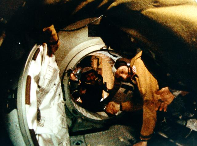 Astronaut Thomas P. Stafford (f.g.) and cosmonaut Aleksei A. Leonov shake hands after a successful Apollo-Soyuz linkup in space, NASA photo astp-S75-29432.jpg